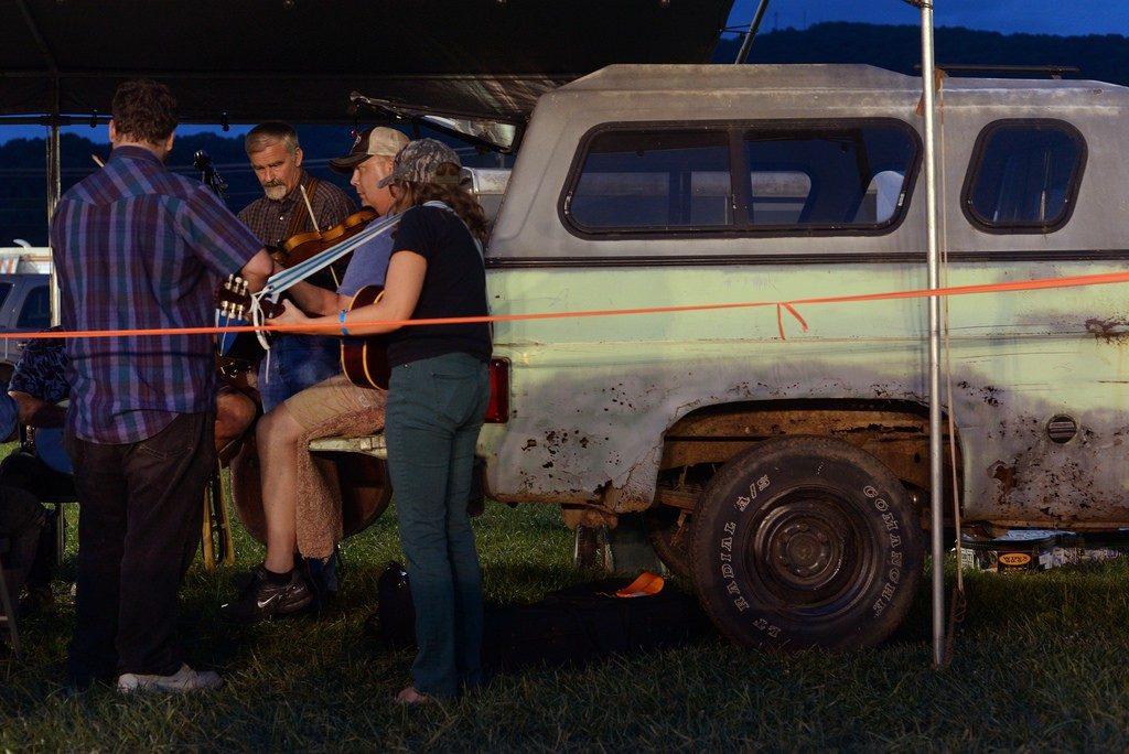 Dennis Hall and Eddie Bond of the New Ballard Branch Bogtrotters jam at the green truck at the 80th Old Fiddlers Convention in Galax, Virginia on Tuesday, 8/4/15. Pat Jarrett/The Virginia Folklife Program