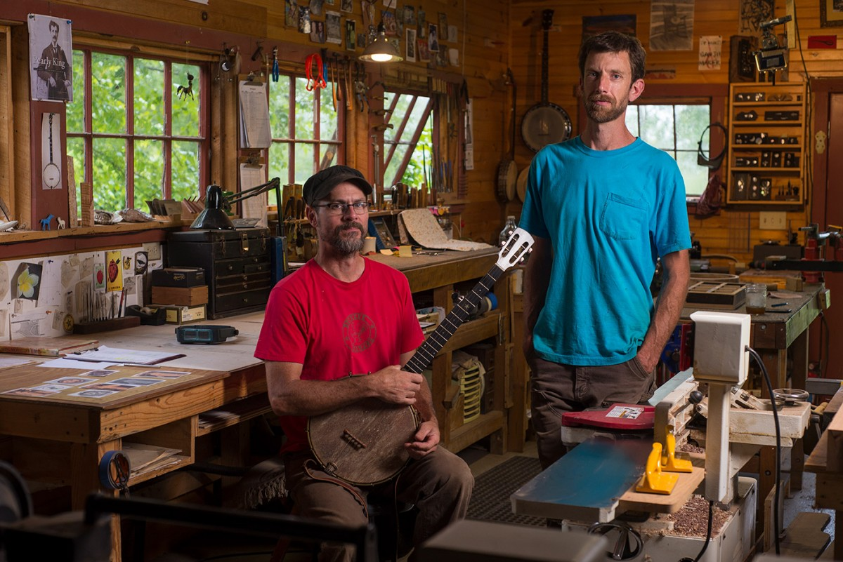Greg Galbreath, left, is training apprentice Peter Keller in the art of old-time banjo making and the intricate inlay Galbreath is known for. The pair photographed at Buckey Banjos in Eggleston, Virginia on 8/11/17.